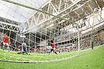 Stockholm 2015-07-16 Fotboll Kval Uefa Europa League  AIK - FC Shirak :  <br /> AIK:s Henok Goitom g&ouml;r 1-0 bakom FC Shiraks m&aring;lvakt goalkeeper Vsevolod Ermakov <br /> (Foto: Kenta J&ouml;nsson) Nyckelord:  AIK Gnaget Tele2 Arena UEFA Europa League Kval Kvalmatch FC Shirak Armenien Armenia jubel gl&auml;dje lycka glad happy
