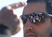Mar 30, 2007; Martinsville, VA, USA; Nascar Nextel Cup Series driver David Stremme (40) is reflected in the glasses of teammate Juan Pablo Montoya (42) during practice for the Goody's Cool Orange 500 at Martinsville Speedway. Martinsville marks the second race for the new car of tomorrow. Mandatory Credit: Mark J. Rebilas