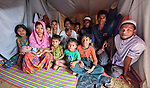 This extended Rohingya family lives in a crowded makeshift shelter in the Chakmarkul Refugee Camp near Cox's Bazar, Bangladesh. More than 600,000 Rohingya have fled government-sanctioned violence in Myanmar for safety in Bangladesh.