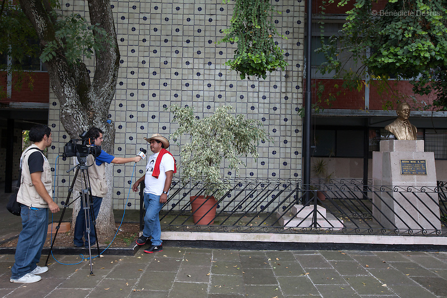 Epifanio Alvarez Carvajal, father of Jorge Álvarez Nava, one of the 43 missing students from Ayotzinapa's teacher training college gives a press intrerview to Televisa in Morelia, Michoacan, Mexico on November 19, 2014. The relatives of the 43 missing students still do not believe the official line that the young men are all dead, and with classmates, social organizations and human rights defenders, they started on Thursday a national caravan. They split up into three different caravans, branching out to share information face to face with supporters in other cities and rally nationwide support. The three groups will meet in Mexico City on Thursday 20 for a general strike and massive marches to demand justice and fight against corrupted government and organized crime. Criticism of the government has intensified in Mexico, and many are demanding that the search for the 43 missing students continue until there is concrete evidence to the contrary. (Photo by BénédicteDesrus)