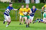 Kevin Coughlan Gneeveguilla breaks away from Ronan Sayers and Jonathan Carey Laune Rangers during their Division 3 clash in Killorglin on Saturday evening