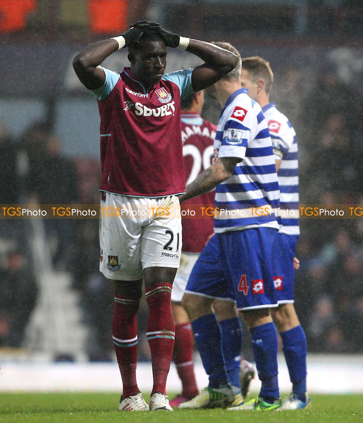 Frustration for Mohamed Diame of West Ham - West Ham United vs Queens Park Rangers, Barclays Premier League at Upton Park, West Ham - 19/01/13 - MANDATORY CREDIT: Rob Newell/TGSPHOTO - Self billing applies where appropriate - 0845 094 6026 - contact@tgsphoto.co.uk - NO UNPAID USE.