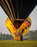 A near record crowd hot air balloon fans filled the hillsides at the National Balloon Classic launch field July 30 for a fly-in and Night Glow. Balloonists flew in to the balloon field located east of Indianola.
