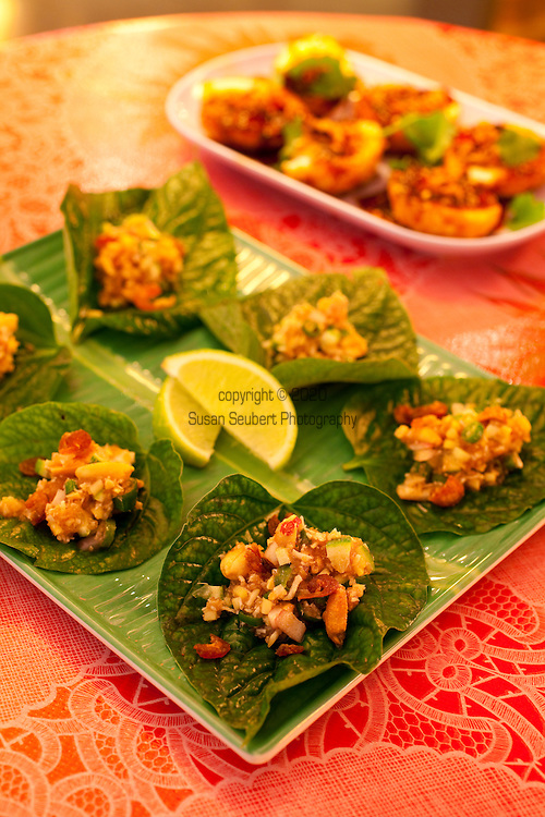 The Whiskey Soda Lounge in Portland, Oregon's SE Neighborhood serves up aahaan kap klaem, the drinking food of Thailand, and the same drinks menu as its mother restaurant, Pok Pok. Pictured here is the Miang Kham: ginger, chilies, peanuts, dried shrimp, lime, shallot, and coconut with betel leaf wrappers and ginger sauce.