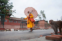 A Hindu holy man walks in the street of Kathmandu, Nepal