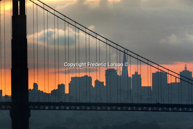 San Francisco skyline was visable as rain clouds lifted during sunrise viewed past the Golden Gate Bridge looking from Point Bonita at the northern entrance to the San Francisco Bay.