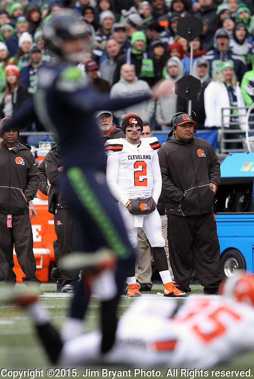 Cleveland Browns quarterback Johnny Manziel (2) watches Seattle Seahawks Steven Hauschka kick a 27-yard field goal at CenturyLink Field in Seattle, Washington on December 20, 2015. The Seahawks clinched their fourth straight playoff berth in four seasons by beating the Browns 30-13.  ©2015. Jim Bryant Photo. All Rights Reserved.