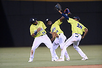 Outfielders from the Columbia Fireflies, including Wagner Lagrange (23), Gerson Molina (12), and Jose Medina (24), celebrate a 5-2 win over the Augusta GreenJackets on Thursday, July 11, 2019 at Segra Park in Columbia, South Carolina. Columbia won, 5-2. (Tom Priddy/Four Seam Images)