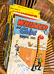 1980s children's cartoon comic book annuals Whizzer and Chips 1985, inside antiques centre, Marlesford Mill, Suffolk, England, UK