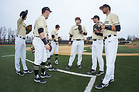 The Wake Forest Demon Deacons prepare to take the field for their ACC baseball game against the Notre Dame Fighting Irish at David F. Couch Ballpark on March 10, 2019 in  Winston-Salem, North Carolina. The Demon Deacons defeated the Fighting Irish 7-4 in game one of a double-header.  (Brian Westerholt/Four Seam Images)