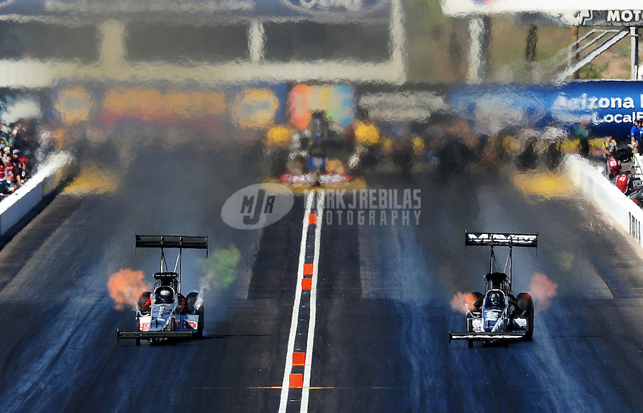 Oct. 15, 2011; Chandler, AZ, USA; NHRA top fuel dragster driver Bob Vandergriff Jr (left) races alongside Dom Lagana during qualifying at the Arizona Nationals at Firebird International Raceway. Mandatory Credit: Mark J. Rebilas-
