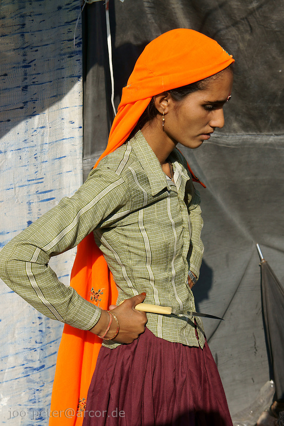 woman on camel fair in holy city Pushkar, Rajastan, India