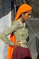 woman on camel fair in holy city Pushkar, Rajastan, India