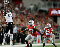 Cincinnati Bearcats wide receiver Alex Chisum (80) leaps to haul in a pass in the fourth quarter of the college football game between the Ohio State Buckeyes and the Cincinnati Bearcats at Ohio Stadium in Columbus, Saturday afternoon, September 27, 2014. The Ohio State Buckeyes defeated the Cincinnati Bearcats 50 - 28. (The Columbus Dispatch / Eamon Queeney)