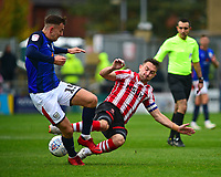Crewe Alexandra's Ryan Wintle is fouled by Lincoln City's Lee Frecklington<br /> <br /> Photographer Andrew Vaughan/CameraSport<br /> <br /> The EFL Sky Bet League Two - Lincoln City v Crewe Alexandra - Saturday 6th October 2018 - Sincil Bank - Lincoln<br /> <br /> World Copyright &copy; 2018 CameraSport. All rights reserved. 43 Linden Ave. Countesthorpe. Leicester. England. LE8 5PG - Tel: +44 (0) 116 277 4147 - admin@camerasport.com - www.camerasport.com