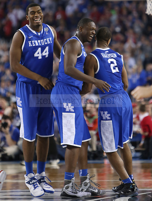 UK teammates celebrate after defeating WIsconsin at the NCAA Final Four vs. Wisconsin at the AT&T in Arlington, Tx., on Saturday, April 5, 2014. Photo by Emily Wuetcher | Staff