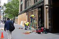 NEW YORK, NEW YORK - JUNE 2: Workers boarded up after a night of looting on stores due to protest on June 2, 2020 in New York City. Protests spread across the country in at least 30 cities across the United States, over the death of unarmed black man George Floyd at the hands of a police officer, this is the latest death in a series of police deaths of black Americans. New York face it's second night of a curfew (Photo by Joana Toro / VIEWpress via Getty Images)