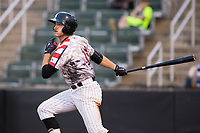 Jameson Fisher (11) of the Kannapolis Intimidators follows through on his swing against the Hickory Crawdads in game two of a double-header at Kannapolis Intimidators Stadium on May 19, 2017 in Kannapolis, North Carolina.  The Intimidators defeated the Crawdads 9-1.  (Brian Westerholt/Four Seam Images)