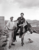 GREECE, photographer Brown Cannon with Shepard Stephanos and his donkey Alekos on the island of Patmos (B&W)