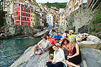 Students enjoy the wonder of Riomaggiore in Cinque Terra Naitonal Park a UNESCO World Heritage Site, Italy