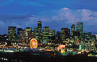 Scenic Denver night skyline with an amusement park in the foreground. Denver, Colorado.