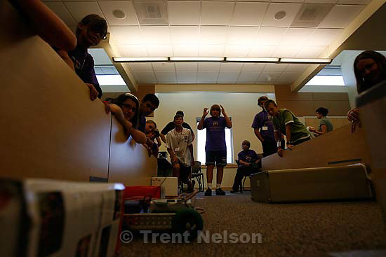 """Salt Lake City - """"Turtle"""", a robot built and programmed by Mason Slack (white shirt) and Dmitrij Coombs, makes its way through the obstacle course. Students at Westminster College's Robotics Camp compete in the """"Robot Challenge,"""" where their custom robots must navigate an obstacle course, Friday, July 17, 2009. Westminster has hosted """"College Experience Camps"""" where students stay a week on campus and experience what it's like to be a college student. Camp themes include Robotics, Aviation, Writing Your World and Money 101.."""