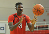 Kassoum Yakwe #14 of of St. John's University men's basketball hones his hand-eye coordination with catching and passing drills after Media Day at Lou Carnesecca Arena in Jamaica, NY on Thursday, Oct. 27, 2016.