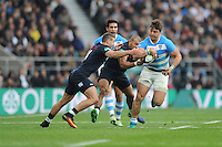 Facundo Isa of Argentina forces his way past Jonny May and Mike Brown of England during the Old Mutual Wealth Series match between England and Argentina at Twickenham Stadium on Saturday 26th November 2016 (Photo by Rob Munro)