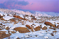 711700250 winter sunrise with snow covered granite boulders in the bureau of land management protected land the alabama hills in the southern section of the eastern sierras in kern county california