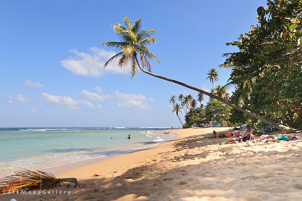 People enjoying the Toco beach - one of the few coral lagoon beaches in Trinidad