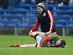 Evan Talty of  Kilmurry Ibrickane is helped by physio Michelle Downes before their senior football final replay against Cratloe at Cusack park. Photograph by John Kelly.
