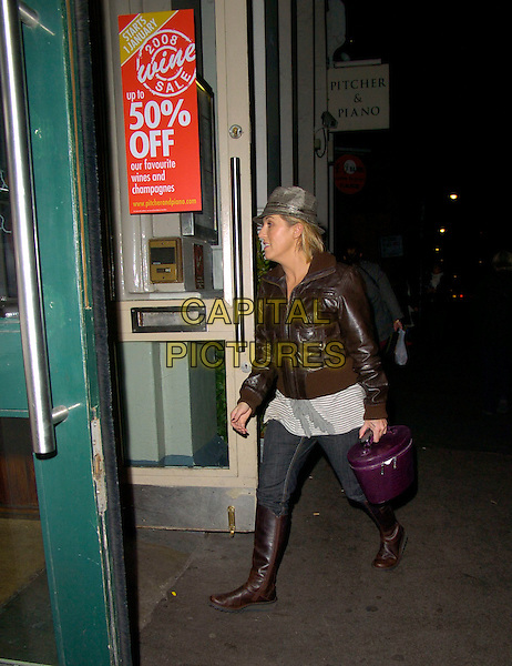 """JESSIE WALLACE.At the """"Rent"""" Musical Cast Change First Night Performance at the Duke Of York's Theatre, London, England, .December 27th 2007..full length brown leather bomber jacket jeans boots hat  purple vanity case bag.CAP/CAN.©Can Nguyen/Capital Pictures"""