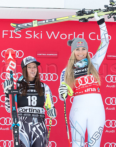 24.01.2016. Cortina d Ampezzo, Italy. FIS World Cup Womens Super G Downhill. Winner Lindsey Vonn of the USA on podium during the award ceremony with Tina Weirather (LIE, 2nd Place)