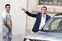 Roma, 25 Luglio 2014<br /> Il presidente del Consiglio Matteo Renzi ha ricevuto oggi a Palazzo Chigi l'AD di Fiat Sergio Marchionne e il presidente John Elkann, che hanno presentato al premier la nuova Jeep Renegade. <br /> Nella foto Renzi e un lavoratore del team Fiat.<br /> Fiat, Elkann and Marchionne have to Renzi new Jeep Renegade. <br /> <br /> Rome, July 25, 2014 <br /> The President of the Council Matteo Renzi received today at Palazzo Chigi, the CEO of Fiat, Sergio Marchionne and Chairman John Elkann, who presented to the premier the new Jeep Renegade.