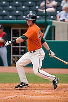 Jeremy Synan #40 of the Greensboro Grasshoppers follows through on his swing versus the Kannapolis Intimidators at NewBridge Bank Park June 20, 2009 in Greensboro, North Carolina. (Photo by Brian Westerholt / Four Seam Images)