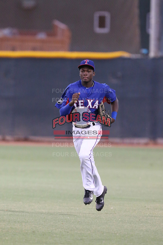 Eric Jenkins (2) of the AZL Rangers returns to the dugout during a game against the AZL Angels at the Texas Rangers Spring Training Complex on July 1, 2015 in Surprise, Arizona. Rangers defeated Angels, 3-1. (Larry Goren/Four Seam Images)