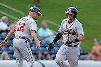 Catcher Chase Anselment (37) of the Rome Braves is congratulated by manager Randy Ingle after hitting a home run in a game against the Greenville Drive on Wednesday, August 21, 2013, at Fluor Field at the West End in Greenville, South Carolina. Rome won, 6-2. (Tom Priddy/Four Seam Images)