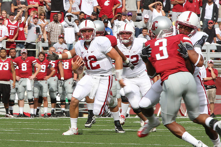 Andrew Luck (#12), Stanford redshirt freshman quarterback, gets great downfield blocking by Chris Owusu on Washington State defensive back, Brandon Jones (#3), during Stanford's 39-13 Pac-10 conference football victory at Martin Stadium in Pullman, Washington, on September 5, 2009.