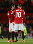 Juan Mata of Manchester United relinquishes the captains arm band to Wayne Rooney of Manchester United during the Premier League match at the Old Trafford Stadium, Manchester. Picture date: November 27th, 2016. Pic Simon Bellis/Sportimage