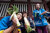 Older Japanese women pose with a white radishes carved in to the shape of a penis and vagina at the Kanamara matsuri or festival of the Steel phallus Kawasaki Daishi, Kawasaki, Kanagawa, Japan. Sunday, April 2nd 2017. The Kanamara Penis festival takes place on the first Sunday of April and celebrates the local legend of a penis eating demon who was defeated after being tricked into biting a steel phallus. The festival is popular with Japan's gay community and now uses its notoriety to raise money for HIV and AIDS charities. It is also wildly popular with foreign and Japanese.tourists.