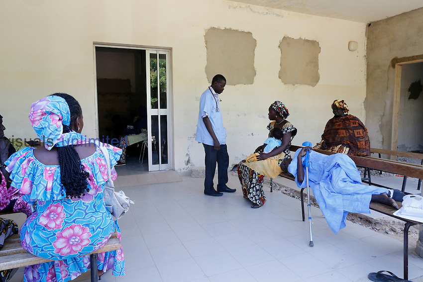 Doctor and patients in waiting room, Fann Hospital, Dakar, Senegal.