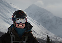 A backcountry skier is all smiles after a successfull descent from a ridge in Alaska's Chugach Mountains.