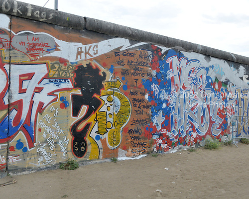 "Berlin, Germany - August 11, 2009 -- Portion of the longest remaining section of the Berlin Wall showing the graffiti on its eastern side in Berlin, Germany on Tuesday, August 11, 2009.  This remaining part of the wall is known as the ""East Side Gallery"" in Friedrichshain near the Oberbaumbrücke over the Spree River..Credit: Ron Sachs / CNP"