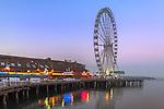 Seattle, Washington<br /> Seattle Great Wheel, a Ferris wheel on the Elliott Bay waterfront at dawn