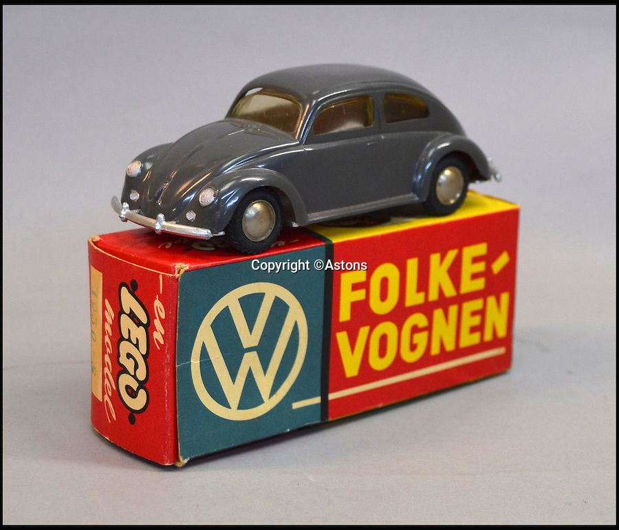 BNPS.co.uk (01202 558833)<br /> Pic: Astons/BNPS<br /> <br /> An early LEGO plastic Volkswagen Beetle.<br /> <br /> A retired historian's remarkable collection of 700 toy cars has sold for almost £100,000.<br /> <br /> Anders Clausager, 67, amassed so many toy cars over the past 60 years he got his own auction to off-load them.<br /> <br /> A collector from Sheffield paid £2,100 for a pack of 12 Lego miniatures set, while a prestigious French Dinky Toys set went for £1,450 and a Corgi Toys set went for £850 at the auction in Dudley.