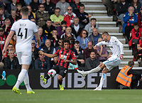 West Ham United's Andriy Yarmolenko (right) crosses the ball despite the attentions of  Nathan Ake (left) on his way to scoreing his side's first goal.<br /> <br /> Photographer David Horton/CameraSport<br /> <br /> The Premier League - Bournemouth v West Ham United - Saturday 28th September 2019 - Vitality Stadium - Bournemouth<br /> <br /> World Copyright © 2019 CameraSport. All rights reserved. 43 Linden Ave. Countesthorpe. Leicester. England. LE8 5PG - Tel: +44 (0) 116 277 4147 - admin@camerasport.com - www.camerasport.com