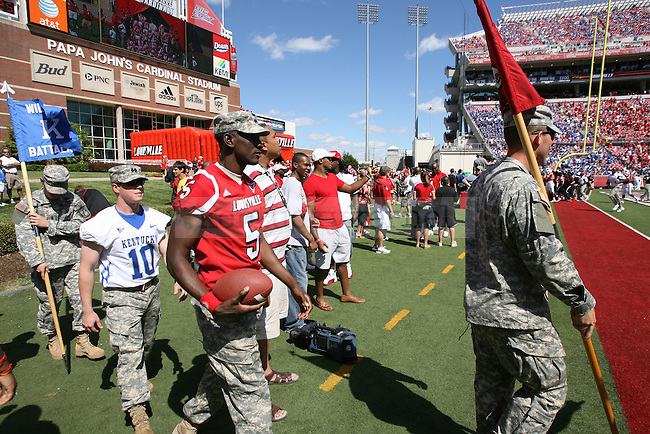 The University of Kentucky ROTC and the University of Louisville ROTC deliver the game ball at Papa John's Cardinal Stadium on Saturday, Sept. 4, 2010. Photo by Scott Hannigan | Staff