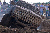 """Mud pit racing, mud racing, mud running or simply muddin"""" is a form of off road racing in which the goal is to drive a vehicle through a pit of mud of a set length. Winners are determined by the distance traveled through the pit or, if several vehicles are able to travel the entire length, the time taken to traverse the pit.  This mud race was a part of the Poteau Balloon Fest held on Halloween weekend 2009 in Poteau Okllahoma."""