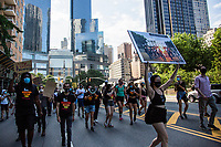 NEW YORK, NY - JULY 4: A group of protesters march from Columbus Circle to Trump Tower during a Black Lives Matter protest in New York, NY, on July 4, 2020. Protests continue in New York and all movements and actions take place in the context of protests against the murder of George Floyd and other African Americans by the police in the United States. (Photo by Pablo Monsalve / VIEWpress via Getty Images)
