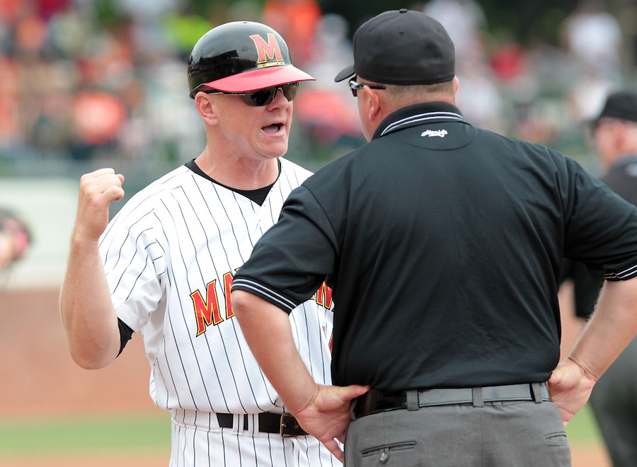 Maryland head coach John Szefc argues with the umpire in the third inning of an NCAA college baseball tournament super regional game against Virginia in Charlottesville, Va., Sunday, June 8, 2014.  (AP Photo/Andrew Shurtleff)